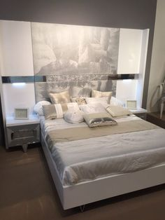 white-platform-bed-with-velvet-nighstand-and-headboard