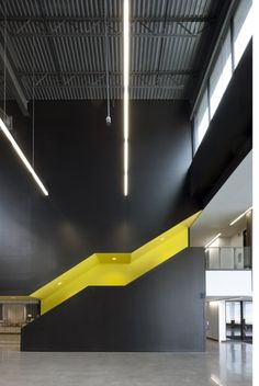 Colored stairs, form, yellow, contrast creates a dramatic space