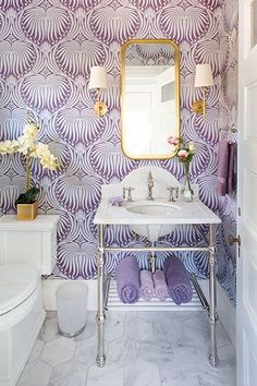 purple wallpaper in powder room bathroom