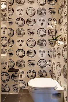 """Piero Fornasetti (1913-1988). The """"Tema a Variazioni"""" (theme and variation) which features the face of a woman, is operatic soprano Lina Cavalieri. Fornasetti found her face in a 19th century magazine. He was so fascinated with her face that he went on to create over500 variations of it in his art"""