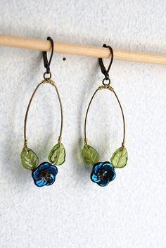 Blue peacock flower earrings by yotldesigns on Etsy, $28.00....pretty