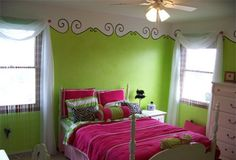 Lime green room with adorable stencil trim at top of room!