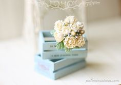 miniature flower bouquet and boxes. Lovely colors