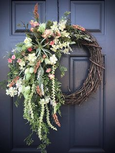 Spring Wreaths, Coral Peach Wreath, Gift for Her, Housewarming, Pretty Wreaths, Spring Door Decor, Spring Wreaths, Coral Colors, Mothers Day I love the texture of this design. Heavily decorated on the left side, this wreath is filled with a wide variety of greenery with a splash or