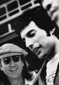 John Lennon and Freddie Mercury.I believe the lead singer in the musical group Muse is channeling Freddie Mercury! Yoko Ono, Music Is Life, My Music, The Beatles, Rock And Roll, Music Poster, Musica Popular, We Will Rock You, Queen Freddie Mercury
