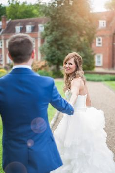Wotton house wedding photography bride and groom holding hands, follow me sun flare