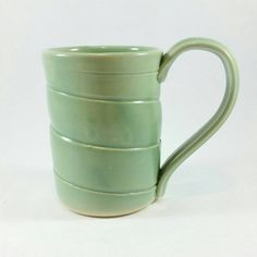 This minty green mug is $20. https://www.etsy.com/listing/224999751/handmade-pottery-mug-light-green-celedon