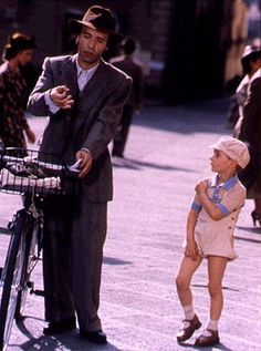 Guido Orefice (Roberto Benigni). Inspiring example of a father. Life is Beautiful. #fathers #fatherhood #truemen #movies