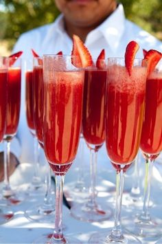 Strawberry Mimosas: 1/3 strawberry puree + 2/3 champagne @}-,-;—