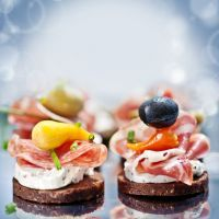 Herb Cream Cheese Crostini with Ham and Olives