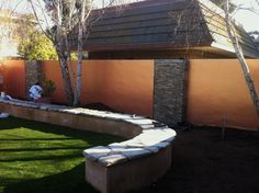 We smooth stucco'd this cinder block wall + 2 coats of primer, and then applied 5 coats of modern masters Metallic.