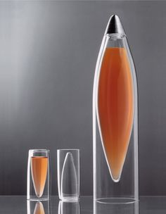 ICETAP Glassware, designed by Paul Sundvik. Lyx.com. Inspired by the icicles that decorate the Swedish winters. Hand blown quartz laboratory glass. The unique shape isolates the liquid... warm or cold... in both glasses and carafe.