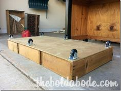 Glue and Screw Drawers to Fiber Board or plywood and add Casters.