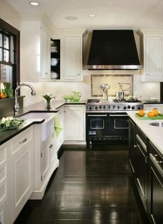 I think we should have a bright kitchen with some dark-wood elements too in order to match our existing furniture.
