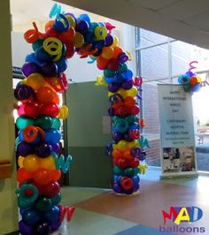 Funky multicolour balloon arch with squiggles | rainbow arch
