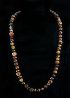 "Brown Faceted Agate Necklace  29"""" Brown faceted agate beads, sterling silver toggle clasp.   http://www.sterlingjewelrystores.com/product606.html"