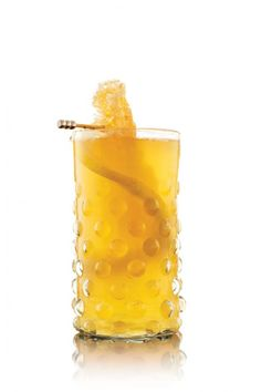 """gin, honey (syrup and comb), lemon (juice and slice) """"Bee's knees"""" cocktail from Garden Design Mag"""