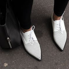 Our Autumn '14 white and black perforated Frankie lace up loafers spotted on the street.  Photo courtesy of Treasurette.