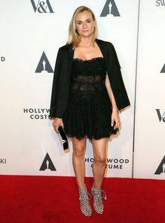 Best Dressed -  Who: Diane Kruger.  Where: The Hollywood Costume Opening Party in Los Angeles. When: October 1, 2014. What: Kruger paired a black lace Elie Saab dress from Spring 2014 RTW with a black Osman blazer, a Charlotte Olympia clutch, and black-and-white Sophia Webster lace-up sandals.  Photo: Getty.