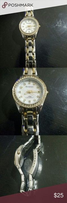 armitron now woman's watch armitron now women's watch with crystals genuine working condition beautiful watch with a pearl inside water resistant hundred sixty-five feet armtorm Accessories Watches