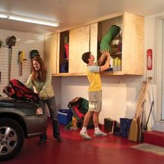 Installing Large Garage Cabinets. Great dust-free storage space.