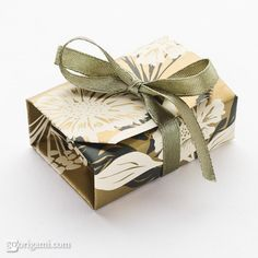 This box appears to be a rectangular box from outside but when you open it up there is another box inside – a square one! It also has a lid which closes down very tightly. The box is made out of a single square sheet of paper without scissors or glue.