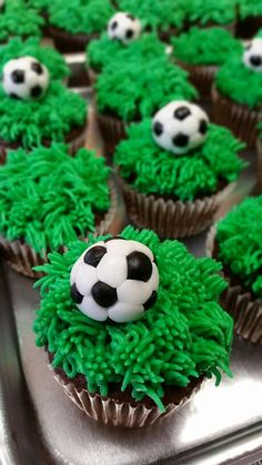 Fondant soccer ball with buttercream grass cupcakes