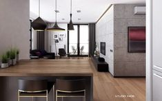 The use of pendant lighting over the adjacent dining space adds interesting style to this modern design. (apartment living for the modern minimalist)