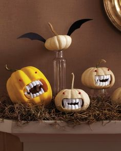 Grouped together on the mantel, these no-carve Drac-o'-lantern and tiny-winged pals create a Transylvanian scene. Run-of-the-mill pushpins turn into devilish red eyes.