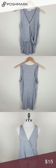 Solid cross over tank Solid cross over tank top  96% rayon 4% spandex  Length 32 in Tops Blouses