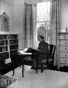 Writing Desks of Famous Authors. pictured Agatha Christie at her typewriter.