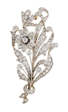 An Edwardian Platinum Topped Gold and Diamond Flower Brooch