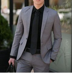 Chapter 24: He in a dark gray suit with a black button down and black tie that made him look so sexy.