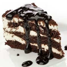 A Delicious Chocolate layer cake recipe, with smooth buttercream icing served with a chocolate drizzle