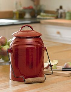 Rustic Kitchen Compost Crock Collecting kitchen scraps for composting shouldn't detract from your kitchen decor. This crock is attractive enough to keep on the kitchen counter so there is no need to hide it under the sink. Red metal compost pail adds a Farmhouse Style Kitchen, Rustic Kitchen, Rustic Farmhouse, Kitchen Decor, Kitchen Ideas, Red Kitchen, Kitchen Designs, Compost Bucket, Homesteads