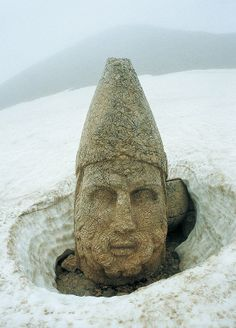 Nemrut or Nemrud (Turkish: Nemrut Dağı) is a 2,134 m (7,001 ft) high mountain in southeastern Turkey, notable for the summit where a number of large statues are erected around what is assumed to be a royal tomb from the 1st century BC.
