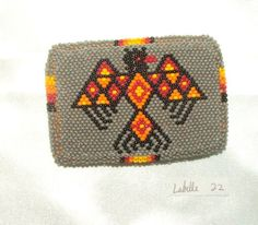 "Belt Buckle Native American Beadwork Gray Thunderbird 3.5x2.5"" A well made beaded belt buckle. Beadwork is sewn over a sturdy cast metal buckle & has a leather backing.  Native American made $75.00 w/ free shipping. #nativeamerican #buckle #beadwork"