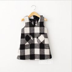 "Plaid Dress with Pockets | black + white | lined, front pockets, ribbon tie in back | $34  3T: shoulder to hem 21"", 24"" chest  4T: sth 22"", 25"" c 5T: sth 23"", 26"" c 6T: sth 24"", 28"" c 7/8: sth 25"", 29"" c"