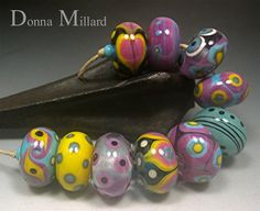Inspired by Gudrun's clothes. Handmade LAMPWORK Glass Bead Set by DonnaMillard