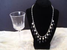 This is an incredible black and white ceramic drop bead necklace. Very elegant and would go well with any evening dress or business attire.  Barrel clasp, 8mm glass beads.   I do design jewelry so if you have something special in mind just contact me and ...