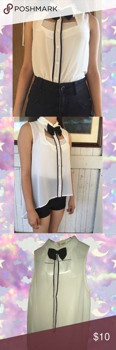 Button up black and white with a bow Dress up button up shirt. Black and white. Formal. Small. Black bow is attached and is a woman way to dress up like a guy. Super cute Kawaii and open in the front and back. #black #white #bow #kawaii #shirt #dressup #cute #small #s #formal Tops Blouses
