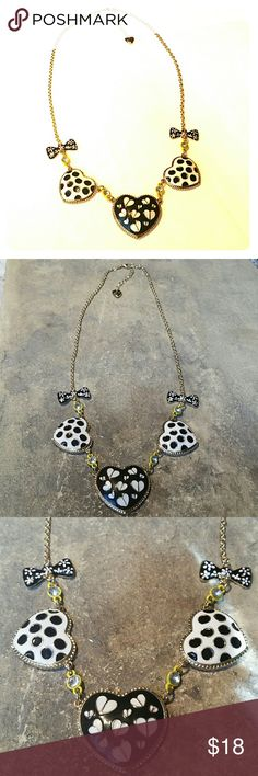 """Black White Yellow Hearts Betsey Johnson Necklace New without tags, never worn, Betsey Johnson shiny gold metal and enamel necklace with black & white hearts connected by bright yellow links with crystal rhinestones and accented with black bows with white daisy flowers, and a BJ puffy heart charm on the chain extension, so pretty! The center heart is 1 3/8"""" wide, the chain is 23"""" plus 2"""" extension chain.  Thank you for checking out my closet, and happy poshing!! :)  SORRY, NO TRADES  BUNDLE…"""