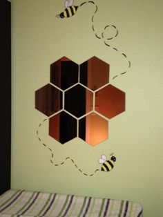 Used hexagonal set of mirrors from Ikea to make a beehive mirror to go above changing station.