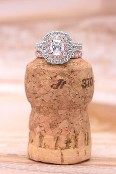 Get ready to celebrate! Henri Daussi engagement ring and matching wedding band. #DoubleHalo #EngagementRing - Long's Jewelers