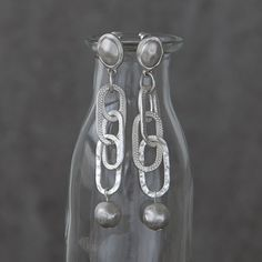 Long and delicate linked chain earrings with metal ball bead, a great pair to dress up an outfit.  Available in Antique Silver.  Designed by Tutti&Co AW14 (EA57S)