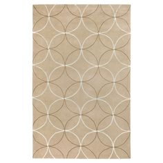 Hand-tufted rug with a geometric motif.Product: Rug    Construction Material: 100% Polyester   Color: ...