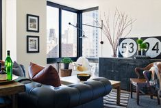A NYC Apartment - they chose a palette of white dove, black, and dusty, egg-y shades, and mixed in contrasting stripes, vintage finds from eBay and Etsy