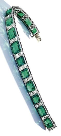 An Art Deco Emerald and Diamond Bracelet, Tiffany & Co., Circa 1925. The octagonal and rectangular step-cut emeralds weighing approximately 39.60 carats, spaced by square emerald-cut diamonds weighing approximately 9.50 carats, mounted in platinum, signed Tiffany & Co. #Tiffany #ArtDeco #bracelet