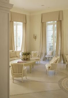 Mary Douglas Drysdale Design | This room is a study in monochromatic colour scheme done beautifully! Note the different tones of soft colours used everywhere including the drapery panels.  The bottom 2-3′ is a different colour than the rest of the drapery….and I LOVE  the tailored valances:  classic but fresh.