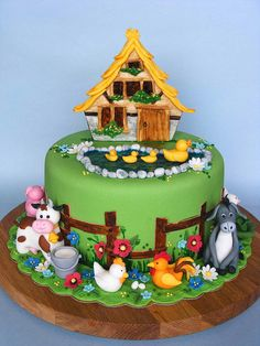 Old MacDonald's farm cake - odd that they chose a chalet instead of a barn, but the chalet is adorable.